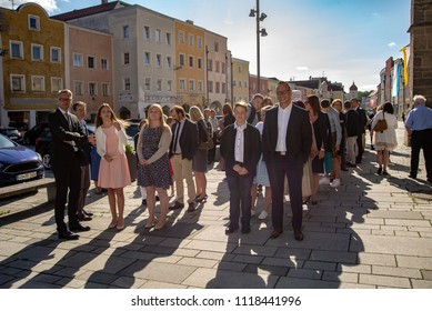 Neuoetting,Germany-June 22,2018: Families waIt with their children outside the local church before Confirmation mass begins