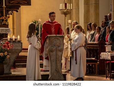 Neuoetting,Germany-June 22,2018: A priest reads from the evangelium during Holy Mass