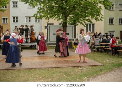 Neuoetting,Germany-June 24,2018: People in typical bavaria clothing dance during a traditional event