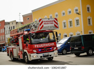 Neuoetting,Germany-May 1,2018: Crooked view of a fire truck with its blue lights flashing