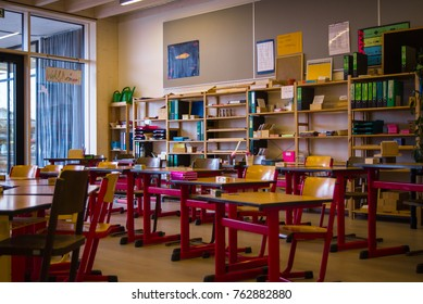 Neuoetting,Germany-Nov 11,2017: Desks and teaching materials in a classroom at a  montessori school