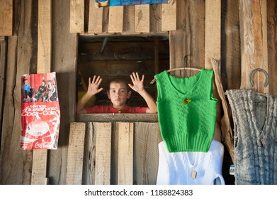 Neuquen, Argentina - January 13 2014: A child Mapuche selling in his mother store in the middle of the Andes mountains, near to Lanin National Park in Southern Argentina. The tribe is known as Mapuche