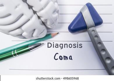 Neurological diagnosis of Coma. Neurological reflex hammer, shape of the brain, pen and pencil the lying on a medical report, labeled with diagnosis of Coma. Concept for neurology