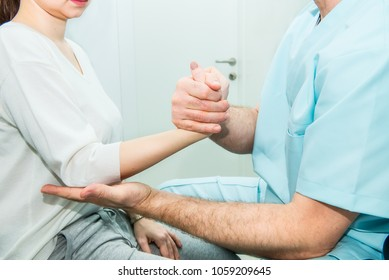 Neurological physical examination of the hands reflexes. Doctor neurologist checks the status of the patient's reflexes in office in hospital. Selective focus, space for text