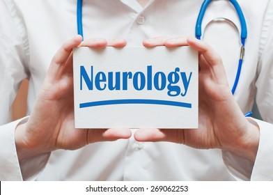 Neurology written on a card in doctor hands