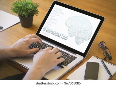 neuromarketing concept. Close-up top view of a man working on laptop. all screen graphics are made up.