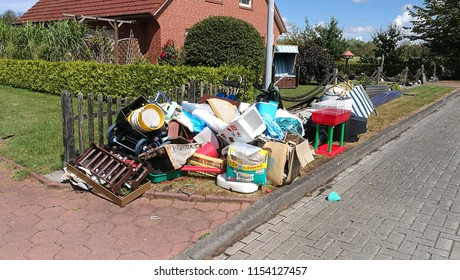 Neuschoo, Germany - August, 2018: bulky waste on the street is waiting for garbage collection. Waste collection. Bulky trash, a pile of mixed garbage. Recycling industry. Ecology concept