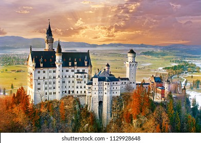 Neuschwanstein, beautiful fairytale castle near Munich in Bavaria, Germany, with colorful trees.