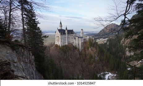 Neuschwanstein Castle is a 19th-century Romanesque Revival palace on a rugged hill above the village of Hohenschwangau near Füssen in southwest Bavaria, Germany.