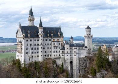 Neuschwanstein castle in Bavaria, Germany. Famous castle Neuschwanstein near Alpsee and Nohenschwangau in Bavarian alps. Bayern (Bavaria), Germany.