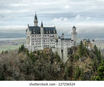 The Neuschwanstein castle in the BavNeuschwanstein castle in the Bavaria Alps (view from the tourists bridge) - Germany aria Alps (view from the bridge) - Germany