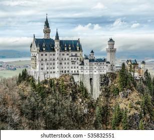 The Neuschwanstein castle in the BavNeuschwanstein castle in the Bavaria Alps (view from the tourists bridge) - Germany aria Alps (view from the bridge) - Germany