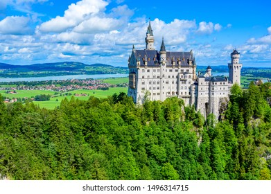 Neuschwanstein Castle in beautiful mountain scenery of Alps- in the background you can see the Lake Forggensee - near Fuessen, Bavaria, Germany