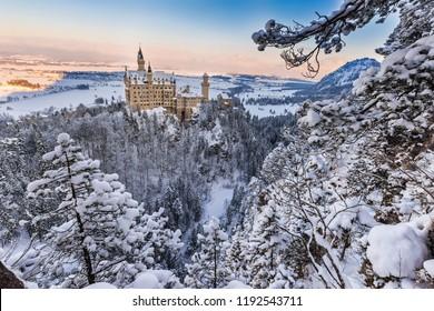 Neuschwanstein Castle during sunrise in winter landscape. Germany
