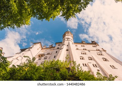 Neuschwanstein Castle famous gothic castle in german bavaria in summer among mountains