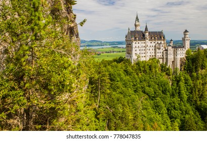 Neuschwanstein Castle in Fussen, Bavaria, Germany. The famous tourist attraction in the Bavarian Alps.