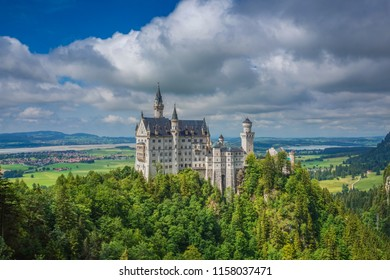 The Neuschwanstein Castle in Germany, Bavaria. It is a 19th-century Romanesque Revival palace on a rugged hill above the village of Hohenschwangau near Füssen in southwest Bavaria, Germany