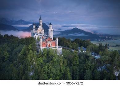 Neuschwanstein Castle, Germany. Image of Neuschwanstein castle during foggy summer twilight.