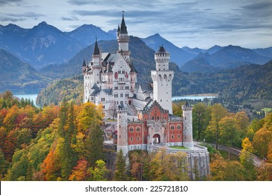 Neuschwanstein Castle, Germany. Image of the Neuschwanstein Castle surrounded with autumn colours during sunset.