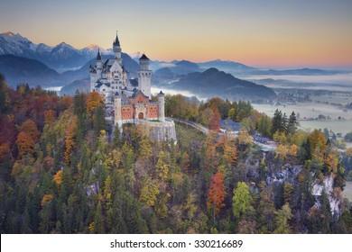 Neuschwanstein Castle, Germany. View of Neuschwanstein Castle during foggy autumn twilight.