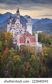 Neuschwanstein Castle. Image of the Neuschwanstein Castle surrounded with autumn colors during sunset.