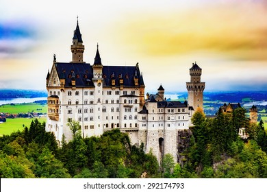 Neuschwanstein Castle, Lovely Autumn Landscape Panorama Picture of the fairy tale castle near Munich in Bavaria, Germany. Sunrise on a cloudy september day