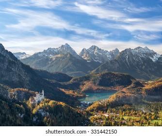 Neuschwanstein castle with mountains in the background, Hohenschwangau, Bavaria, Germany