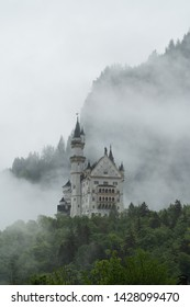 Neuschwanstein Castle with mystery and foggy environment, famous place and travel destination in Fussen, Germany