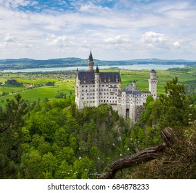 Neuschwanstein Castle is a nineteenth-century Romanesque Revival palace on a rugged hill above the village of Hohenschwangau, Germany