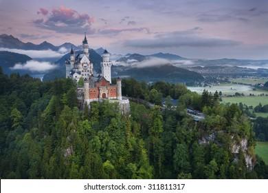 Neuschwanstein Castle. View of Neuschwanstein Castle, Germany during foggy summer morning.
