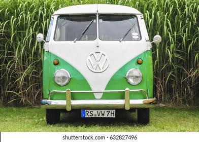 NEUSS, GERMANY AUGUST 2012: OLD GREEN VW VAN FROM 1970 PARKING IN FRONT OF A CORN FIELD