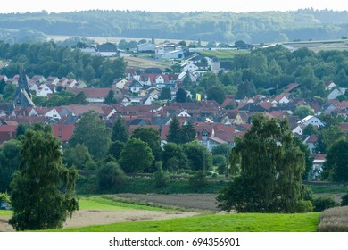 NEUSTADT, GERMANY - JULY 30, 2017: View of the small town of Neustadt (Marburg-Biedenkopf district in Hessen), a suburb and surrounding agricultural land.