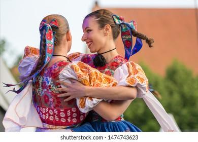 Neustadt in Holstein, Germany - August 03, 2019, European Folklore Festival, Karpaty, folk dancers from Bratislava Slovakia. colorful dressed, traditional female folk dancers dancing on stage