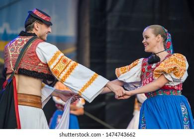 Neustadt in Holstein, Germany - August 03, 2019, European Folklore Festival, Karpaty, folk dancers from Bratislava Slovakia. colorful dressed, traditional folk dancers dancing on stage