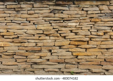 neutral background image. east wall of yellow sandstone. texture of flat stones.