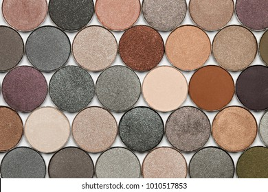 Neutral color eye shadows palette isolated on white background.
