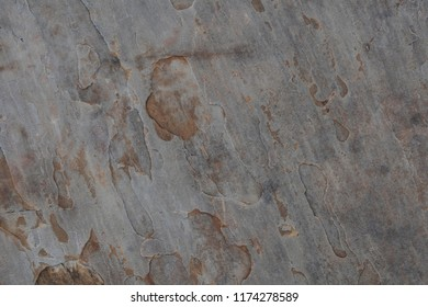 Neutral colored stone background with textured surface