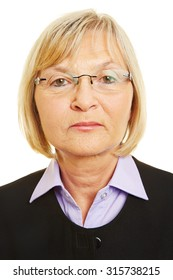 Neutral face of old woman with glasses for biometric passport photo