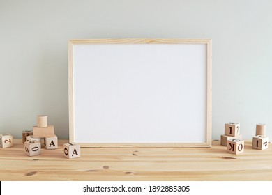 Neutral nursery horizontal frame mockup, empty wooden frame in baby room to showcase artwork, print, photo, painting.         - Shutterstock ID 1892885305