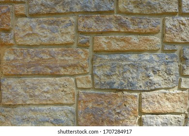 Neutral Stone Wall Background with Varying Size Bricks