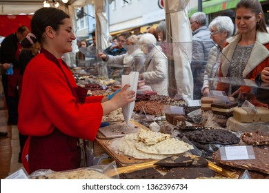 Neuwied, Germany - April 6, 2019: an italian saleswoman ist selling sweets on the Chocolate Festival