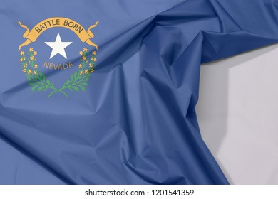 Nevada fabric flag crepe and crease with white space, The states of America, two sagebrush branches encircling a silver star with text Nevada and Battle Born.
