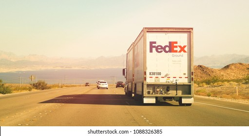 nevada october 2017 fedex delivery trucks crossing from nevada to arizona on us route