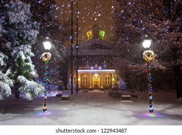 The Nevada state Capitol Building, in Carson City, Nevada. Christmas lights in the middle of a snowstorm.