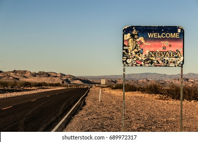 NEVADA STATE LINE, DEATH VALLEY, CALIFORNIA, USA - AUGUST 2017 : Nevada state line sign along the Daylight Pass Road to Beatty (Nevada) at Sunset on summer.