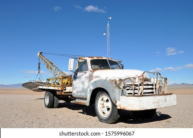 Nevada, USA - 02.10.14: Old vintage car pickup with UFO aliens in desert near zone 51 famous extraterrestrial highway in Nevada close to the Nellis Air Force Range and Area 51