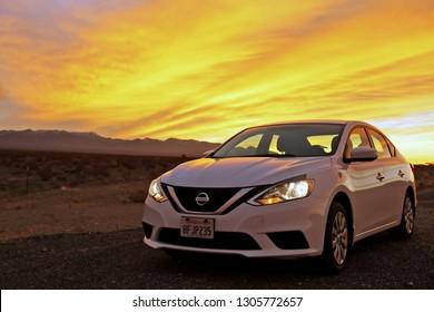 Nevada, USA - Jan 20, 2019: White car Nissan Sentra  at sunset Nevada, US