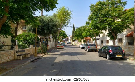 NEVE PINCHAS, HOLON, ISRAEL. April 27, 2017. Cars parked on the side of the Ben Amram street in a tiny Samaritan quarter in Holon.  Samaritans are an ethnoreligious group living in Israel and Samaria.