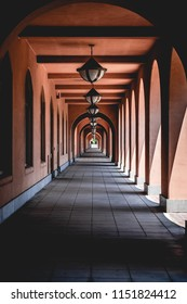 A never ending hallway of lamps and shadows.