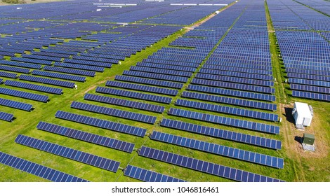Never ending solar energy farm producing clean renewable energy from the sun . Thousands of solar panels, Photovoltaic solar cells , huge solar farm.